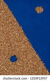 Buckwheat texture, blue textured cloth, diagonal, hole