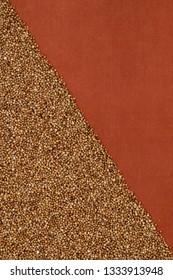 Buckwheat texture,  on terra-cotta cloth, diagonal