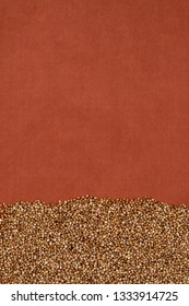 Buckwheat texture  on terra-cotta cloth