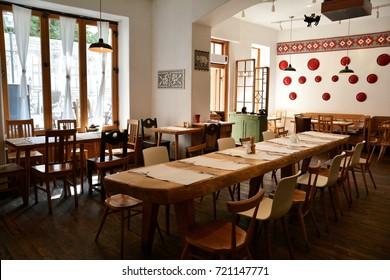 "BUCURESTI, ROMANIA - SEPTEMBER 13, 2017. Interior of the ""Tears and Saints ""(Lacrimi si Sfinti ), high class restaurant on the Sepcari Street in the Old center of Bucharest, capital of Romania"