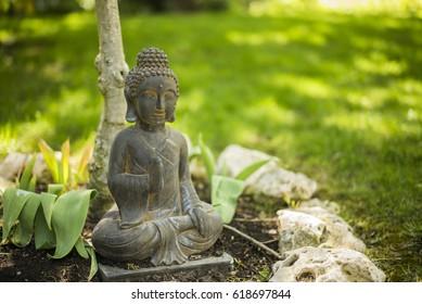 Buda in garden