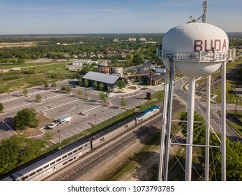 Buda, TX/USA - April 11 2018: Amtrak Train in Downtown Buda with Water Tower