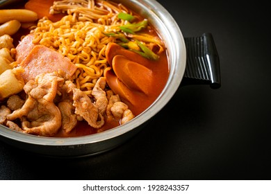 Budae Jjigae or Budaejjigae (Army stew or Army base stew). It is loaded with Kimchi, spam, sausages, ramen noodles and much more - popular Korean hot pot food style