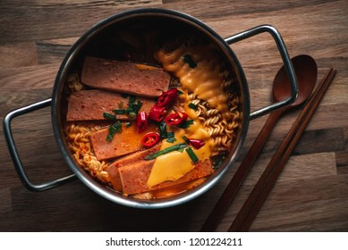 """Budae-jjigae (literally """"army base stew"""") is a type of jjigae (stew), made with ham, sausage, spam, baked beans, kimchi and gochujang."""