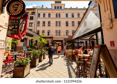 Budaopest, Hungary, April 18, 2018: People shopping and dine out at   Gozsdu Udvar   what is a pedestrian gallery and restaurants in Budapest.