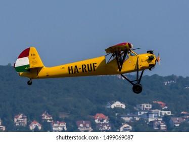 Budaors Hungary August. 31. 2019. Budaorsi AirShow 2019 - Hungarian privat pilot on the oldtimer airplane in the blue sky Rubik R-18 Kanya (HA-RUF)
