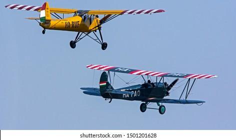 Budaors Hungary August. 31. 2019. Budaorsi AirShow 2019 - Hungarian privat pilot on the oldtimer airplane in the blue sky Rubik R-18 Kanya (HA-RUF) and Polikarpov Po-2 CSS-13 (HA-PAO)