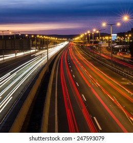 BUDAORS, HUNGARY - JAN 12: Red tail lights and traffic lights in a long exposure photograph over a motorway near Budapest on January 12, 2015 in Budaors Hungary