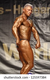 BUDAORS, HUNGARY - JUNE 10: Kovacs Laszlo participates in WBPF bodybuilding World Cup Masters over 50 yrs category on June 10, 2012 in Budaors, Hungary