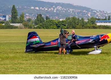 "Budaors Hungary - Sept 01, 2018: AirsShow ""Mult & Jelen"" -The World Champion aerobatic pilot Besenyei Peter (Hungary) Red Bull Corvus CA41 Racer 540 (N806CR)."
