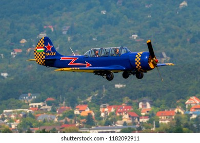 Budaors Hungary - Sept 2 2018: Yak-52 aircraft. Hungarian flying team  performing with Mr. Gy. Vari on the lead.