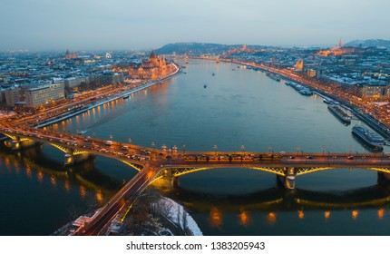 Budapest by night. Hungary - skyline panorama of Budapest in the night. The Danube the Parliament the Chain Bridge and the Buda Castle and the Margaret Bridge in front. Blue hour photo.