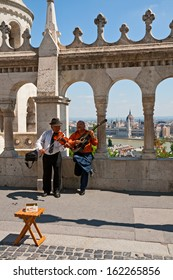 BUDAPEST - CIRCA MAY 2013 Street musicians play for tourists national Hungarian music