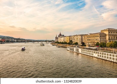 Budapest - a city landscape with the Danube river. Ships on the Danube River. Danube quay and Budapest buildings.