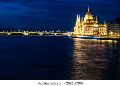 Budapest Cityscape at night. With the Hungarian Parliament and Margit Bridge. Beautiful reflection in the water of Danube river.