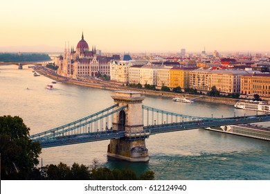 Budapest cityscape, parliament and chain bridge at sunset