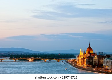 Budapest at dusk with Hungarian Parliament Building and Margaret Bridge on Danube river.