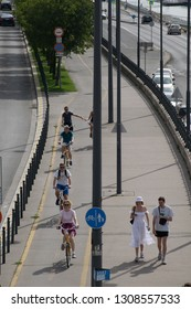 Budapest, Hungagry - september, 15, 2018 - Cyclists and pedestrians share the sidewalk and the bike path on a sunny day at the banks of Danube river