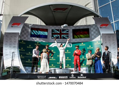 Budapest, Hungary. 01-04/08/2019. Grand Prix of Hungary. F1 World Championship 2019. Lewis Hamilton, Mercedes, on the podium with Verstappen and Vettel, celebrating the victory.