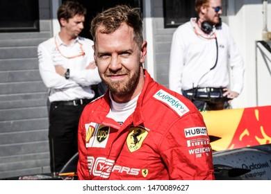 Budapest, Hungary. 01-04/08/2019. Grand Prix of Hungary. F1 World Championship 2019. Max Verstappen, Red Bull, and Sebastian Vettel, Ferrari, smile after the race.