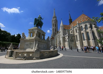 Budapest, Hungary, 03.06.2019. Sculpture monument to first king of Hungary Saint Stephen and church saint Matthias in Fisherman's Bastion