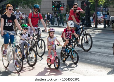 """Budapest, Hungary : 05.06.2018 : A family riding bikes during an event."""
