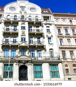 Budapest, Hungary - 09 15 2019: an old monumental restored house with thick walls and open balconies with bas-reliefs in the Baroque style