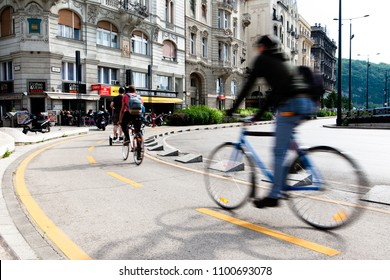 Budapest, Hungary - 18 May, 2018: Bicyclist in traffic on Budapest's road.