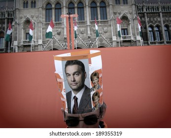 BUDAPEST, HUNGARY - 2, APRIL, 2006: A supporter of Viktor Orban wears a paper crown showing Viktor Orban at a political rally in front of the Parliament in Budapest, Hungary, on 2nd of April, 2006.