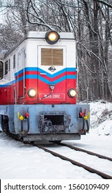 BUDAPEST, HUNGARY - 20 JANUARY, 2019: Winter forest scene with snow and old colorful train on the track in Budapest. - Shutterstock ID 1560109409
