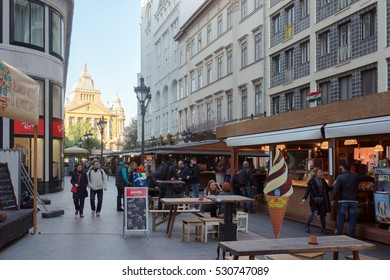 Budapest, Hungary. 21st April 2016. People walking along the central City streets of Budapest by Vorosmarty Ter.