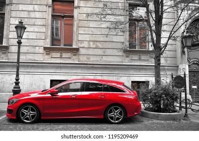 BUDAPEST, HUNGARY - 22 SEPTEMBER: Deep red Mercedes-Benz car in the street of Budapest on September 22, 2018.