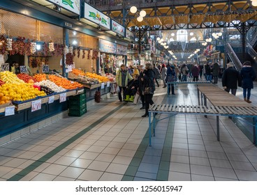 BUDAPEST, HUNGARY - 30 JUNE, 2016: People shopping in the Great Market Hall. It is the largest indoor market in Budapest, it was built in 1896.