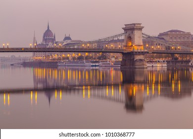 BUDAPEST, HUNGARY - 31ST OCTOBER 2015: A view of the Szechenyi chain bridge and Hungarian Parliament in the morning from across the River Danube.