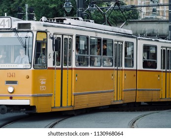 Budapest, Hungary. 4th July 2018 - Yellow vintage tram and tourists during summer vacation period in Budapest