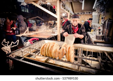 BUDAPEST, HUNGARY - 8 DECEMBER 2016: Langos street food vendor at the traditional Christmas market in Hungary, Europe