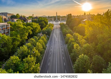 Budapest, Hungary - Aerial drone view of Andrassy street at sunrise with Heroes' Square (Hosok tere) at background at summer time