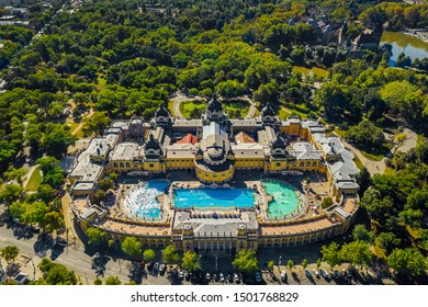 Budapest, Hungary - Aerial drone view of the famous Szechenyi Thermal Bath and Spa in City Park (Varosliget) taken from high above on a sunny summer day. Vajdahunyad Castle at background