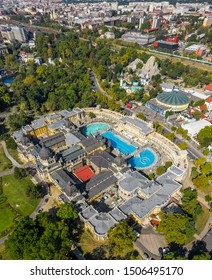 Budapest, Hungary - Aerial drone view of the famous Szechenyi Thermal bath and Spa in City Park (Varosliget) with Budapest Zoo and Capital Circus of Budapest at background on a sunny summer day