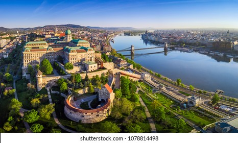 Budapest, Hungary - Aerial panoramic skyline view of Buda Castle Royal Palace with Szechenyi Chain Bridge, St.Stephen's Basilica, Hungarian Parliament and Matthias Church at sunrise with blue sky