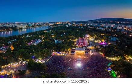 Budapest, Hungary - Aerial panoramic skyline view of Budapest at blue hour with main stage of Sziget festival 2018