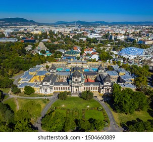 Budapest, Hungary - Aerial panoramic view of the famous Szechenyi Thermal bath and Spa in City Park (Varosliget) with Budapest Zoo and Capital Circus of Budapest on a sunny summer day
