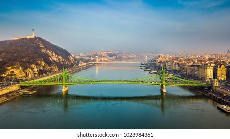 Budapest, Hungary - Aerial skyline view of beautiful Liberty Bridge on a sunny morning with Gellert Hill, Citadella, Statue of Liberty, Elisabeth Bridge and Buda Castle Royal Palace at background