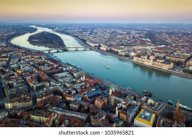 Budapest, Hungary - Aerial skyline view of Budapest with Parliament of Hungary, Margaret Island and Bridge and sightseeing boat on River Danube at sunset