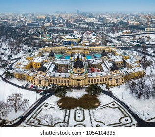 Budapest, Hungary - Aerial skyline view of the famous Szechenyi Thermal Bath in City Park (Varosliget) on a snowy winter morning
