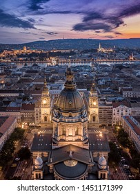 Budapest, Hungary - Aerial view about the towers of the famous St.Stephen's Basilica and Buda Castle, Chain Bridge, Matthias Church at cloudy sunset
