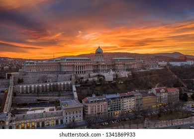 Budapest, Hungary - Aerial view of Buda Castle Royal Palace with a dramatic golden sunset at winter time