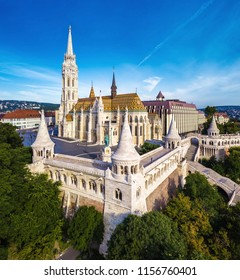 Budapest, Hungary - Aerial view of famous Fisherman's Bastion (Halaszbastya) and Matthias Church (Matyas templom) in the morning with Buda Hills at background