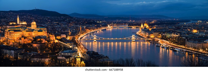 Budapest, Hungary. Aerial view of Budapest, Hungary at night. Buda castle, Chain bridge and Parliament building at sunset