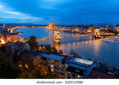 Budapest, Hungary: aerial view of Parliament and Chain Bridge at dusk.